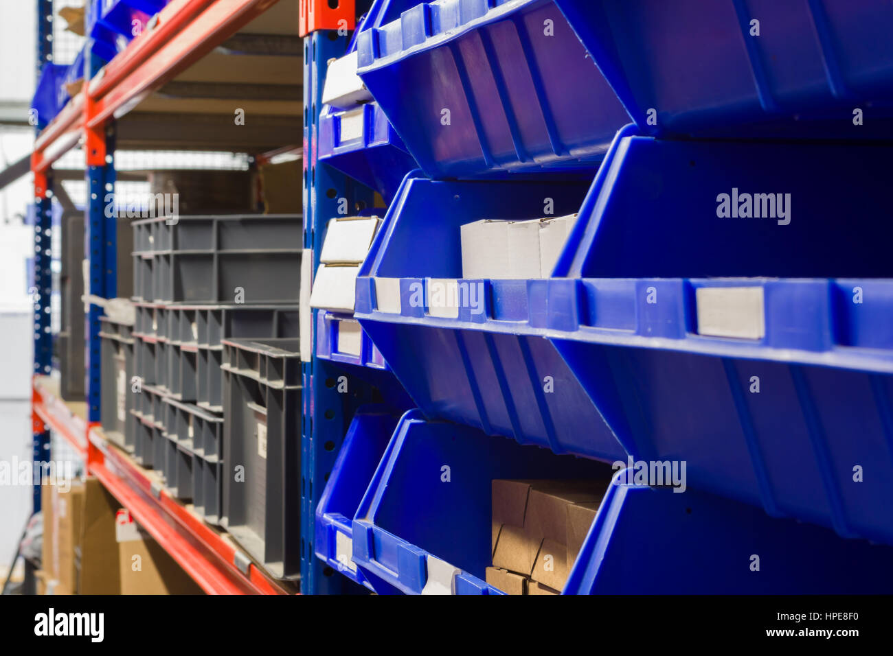 storage bins and industrial storage racks in a warehouse shot with shallow focus - Industrial Storage Racks
