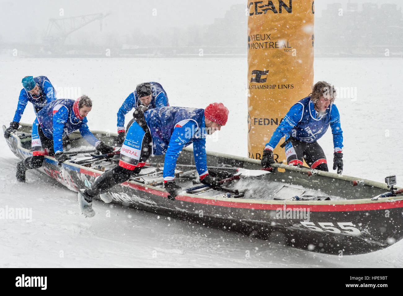 MONTREAL, CA - 12 February 2017: Montreal Ice Canoe Challenge on St-Lawrence River. - Stock Image