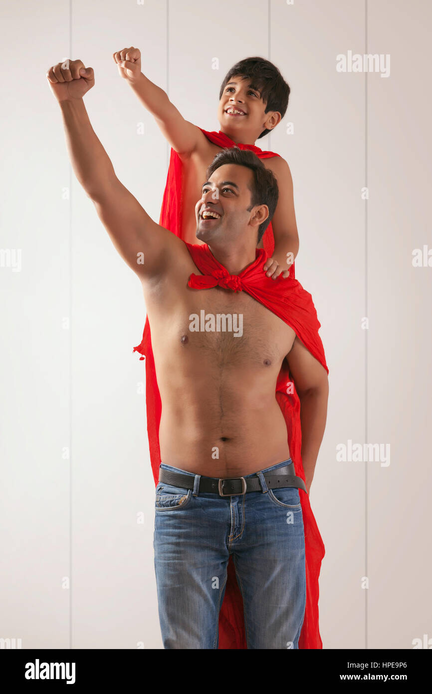 Father and son acting as super heroes Stock Photo