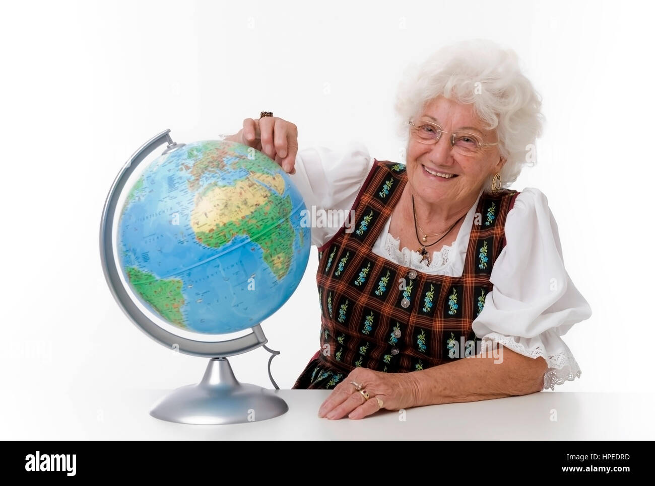 Model released , Seniorin mit Globus - older person with globe - Stock Image