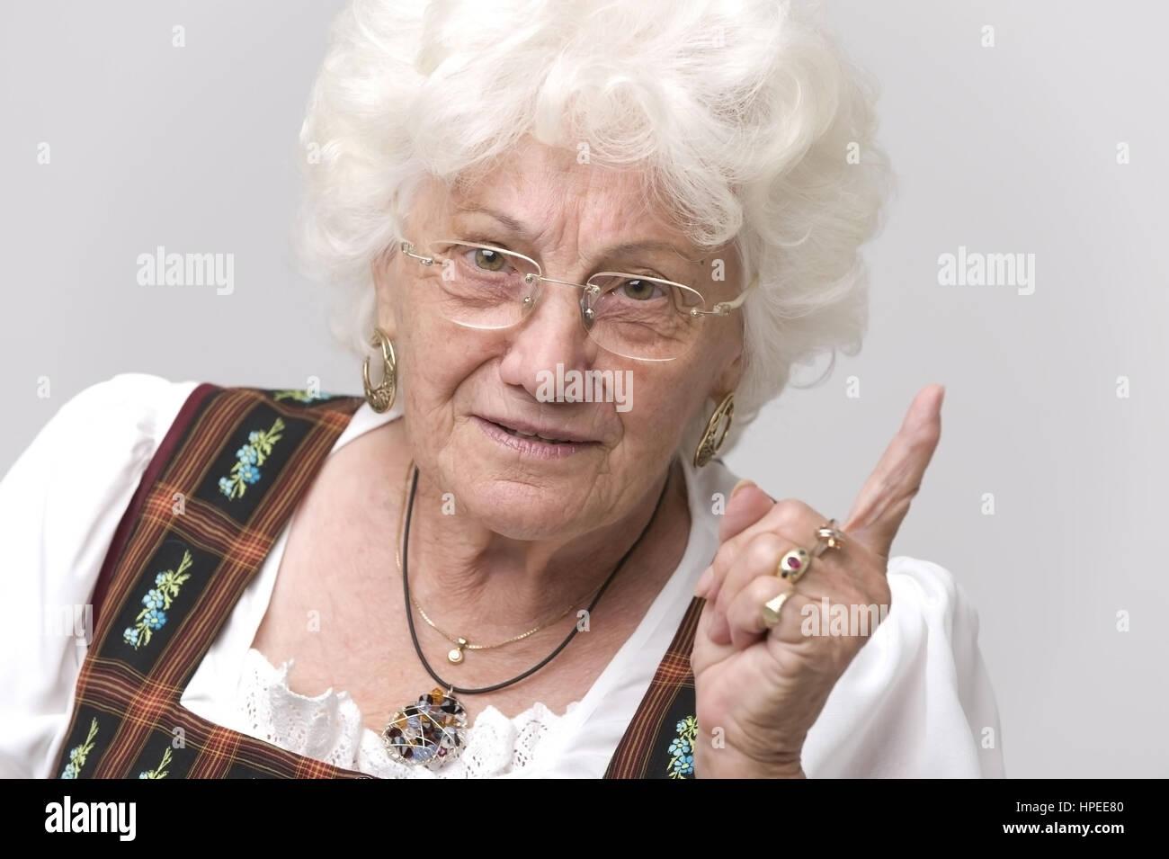 Model released , Seniorin mit erhobenem Zeigefinger - older woman with wagging forefinger Stock Photo