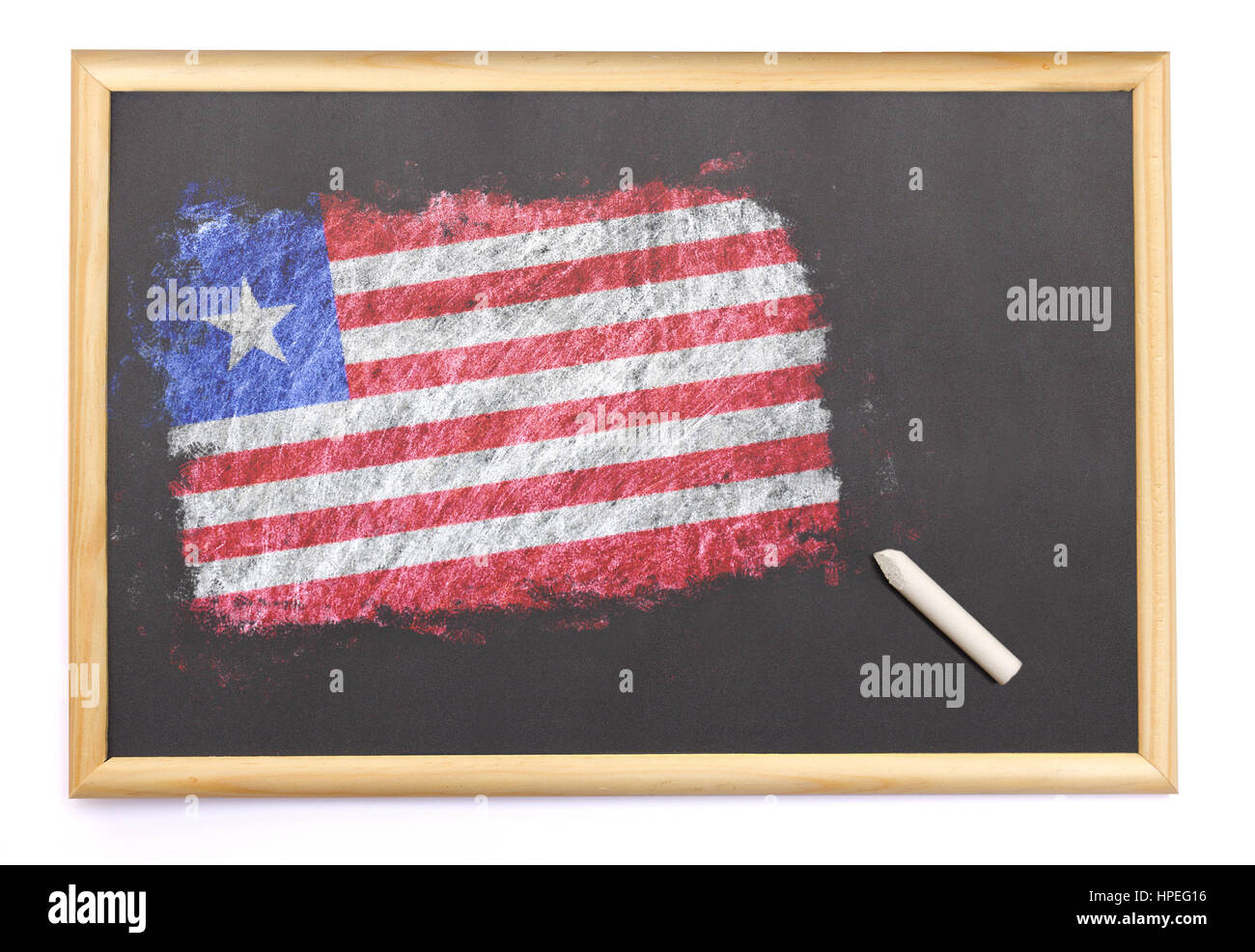 Blackboard with the national flag of Liberia drawn on and a chalk.(series) - Stock Image
