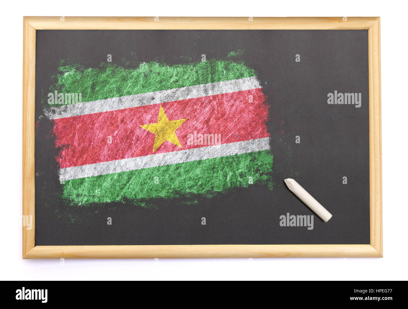 Blackboard with the national flag of Suriname drawn on and a chalk.(series) - Stock Image