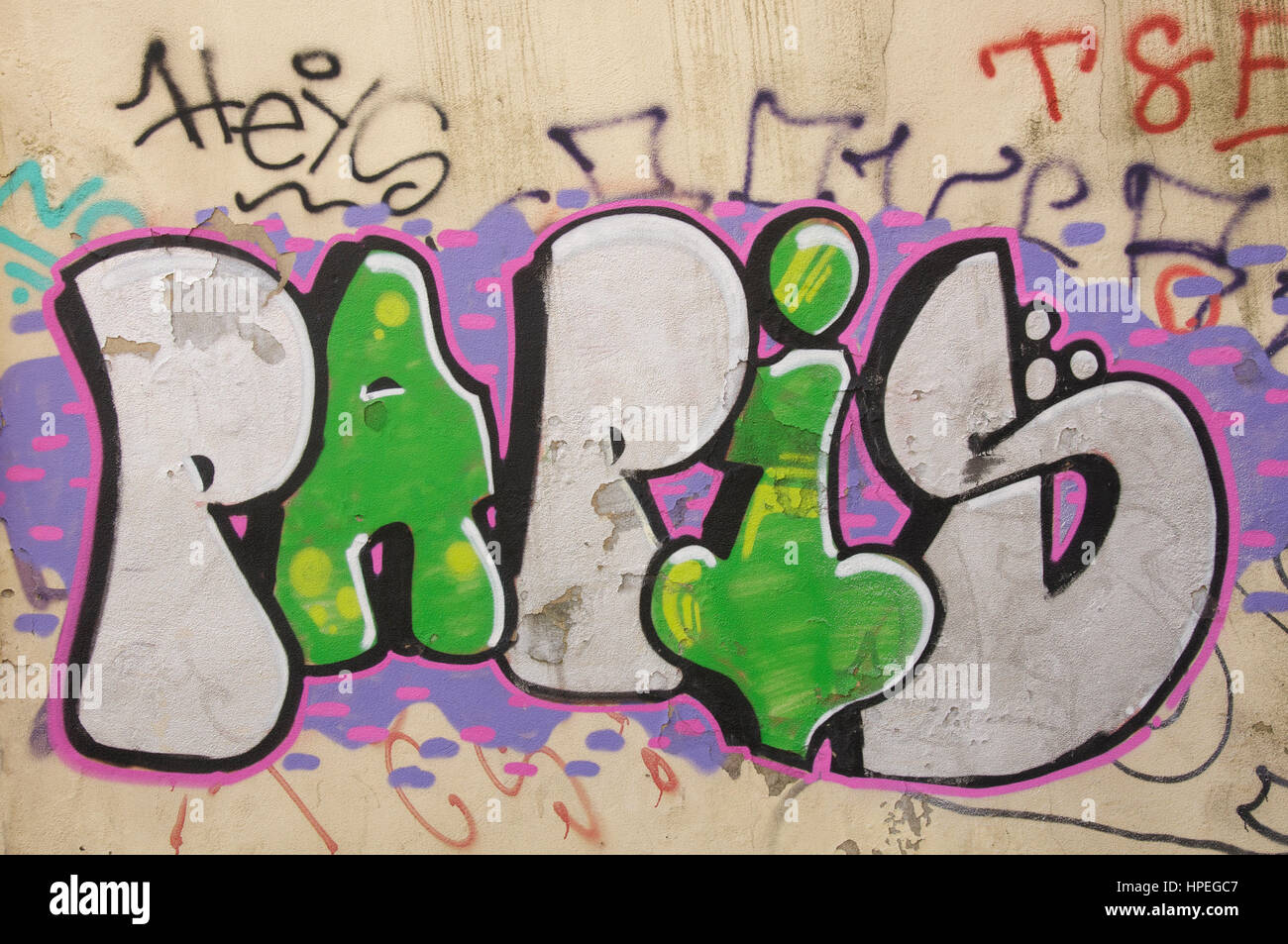 Urban Street Art Green And Silver Graffiti Letters Spray Painted On