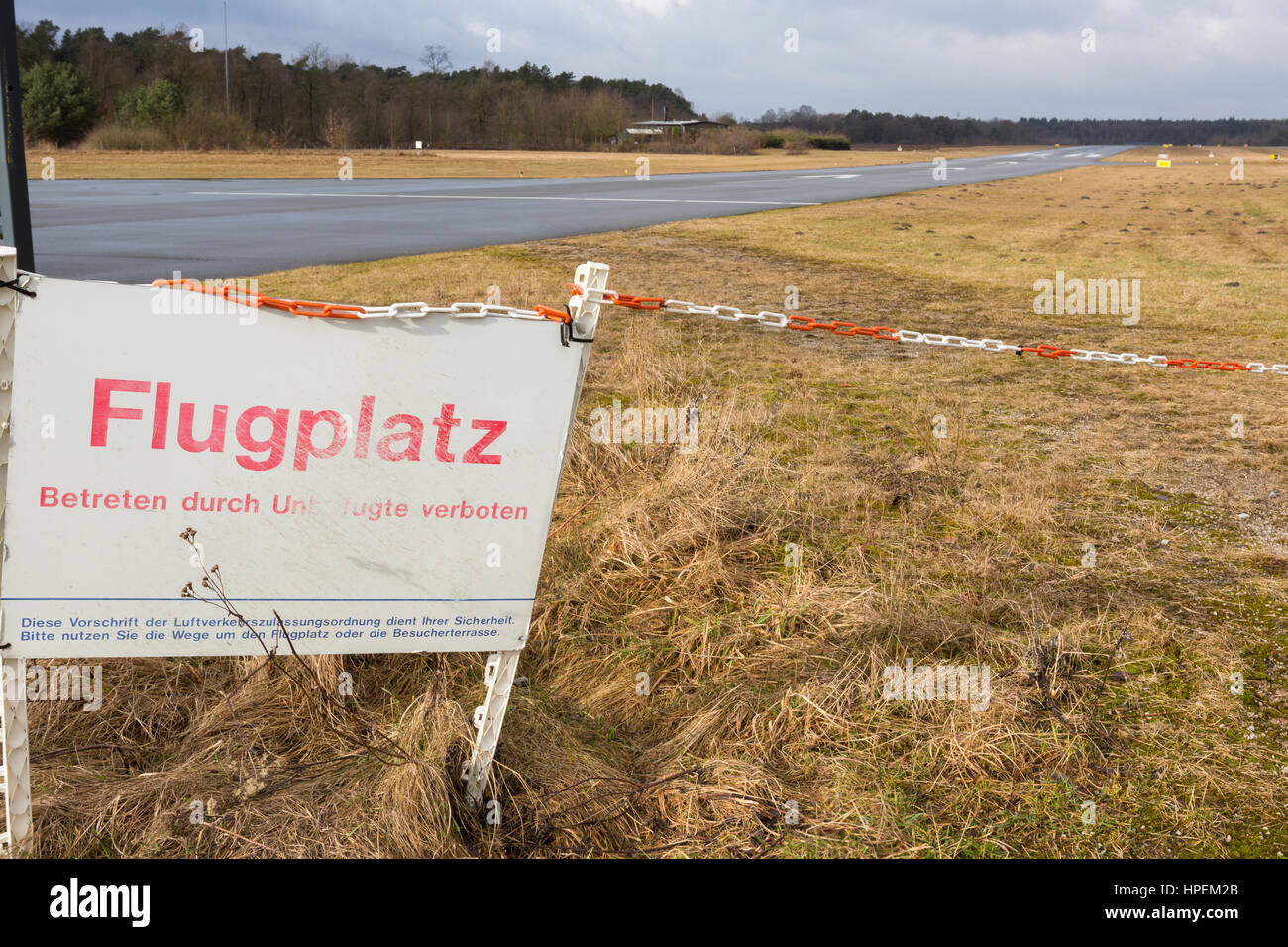 End of runway 29 at Bielefeld-Senne airport, Germany with Flugplatz sign - Stock Image