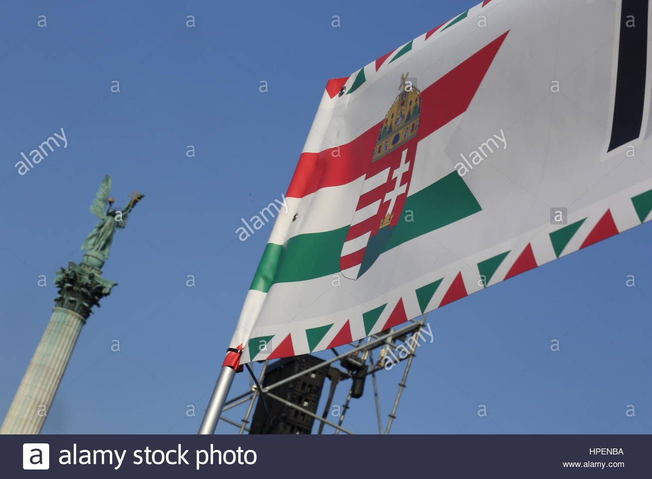 A Hungarian flag and the emblem of St Stephen hangs aloft in Heroes Square, Budapest Stock Photo