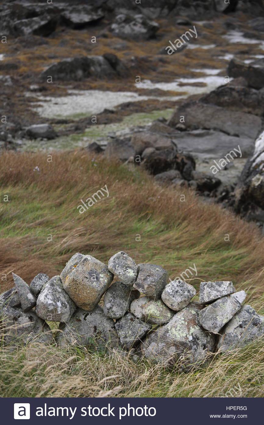 Irish landscape of stone and water at the seashore in Connemara, ireland - Stock Image