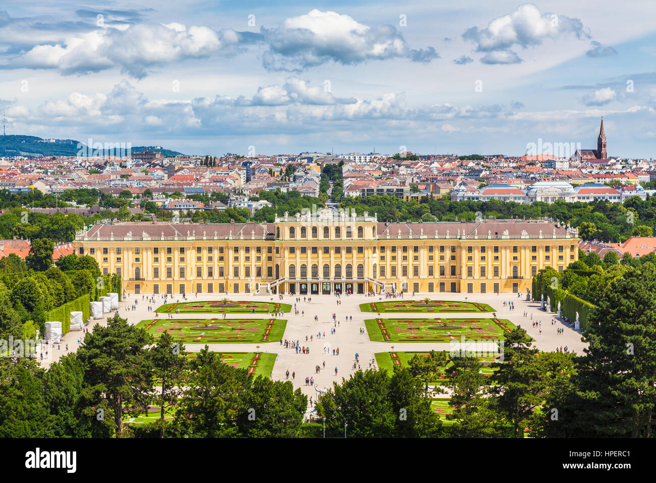 Classic view of famous Schonbrunn Palace with Great Parterre gardens on a beautiful sunny day with blue sky and - Stock Image