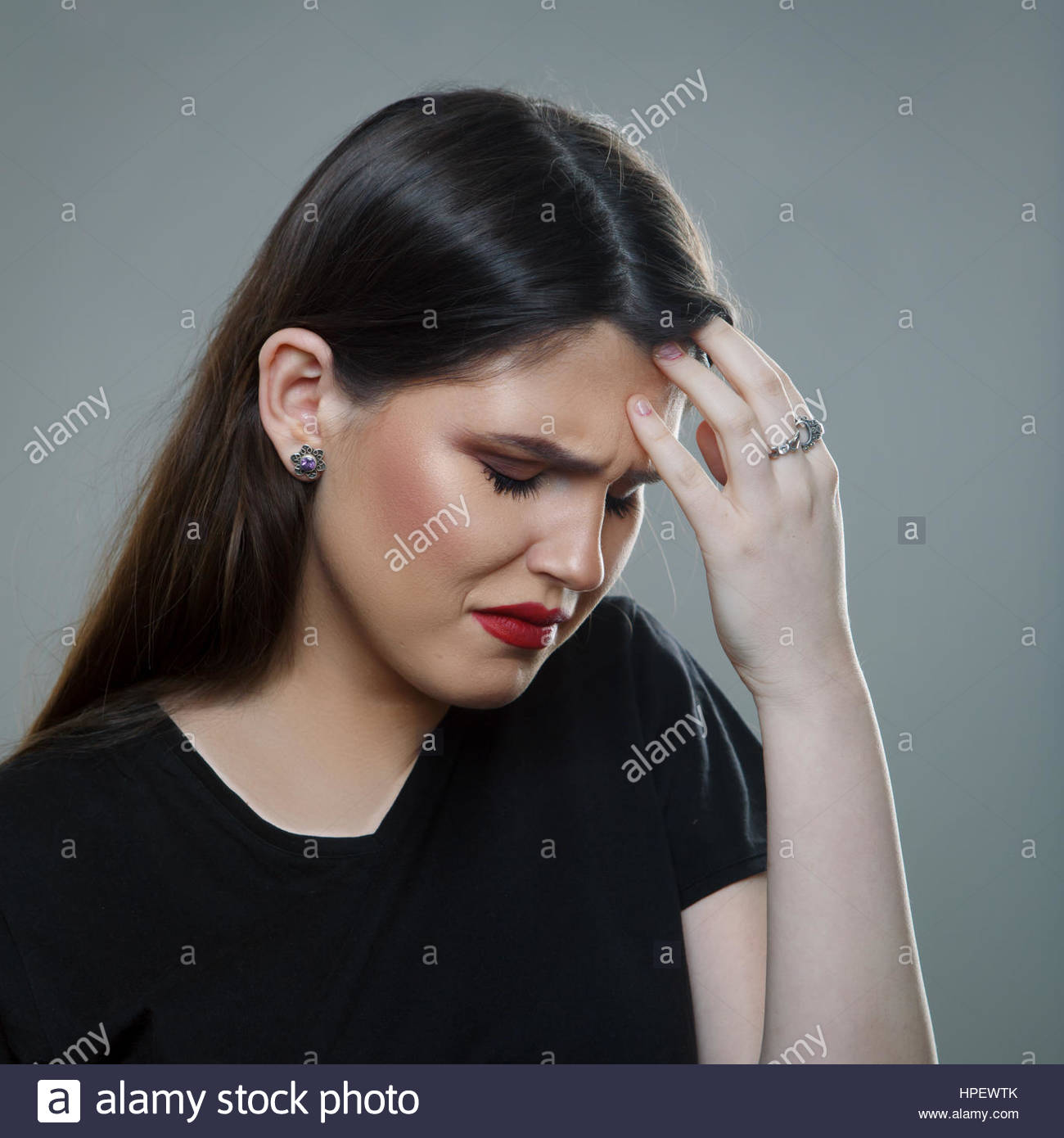 Headache Female. Stressed Young Woman Having Migraines - Stock Image