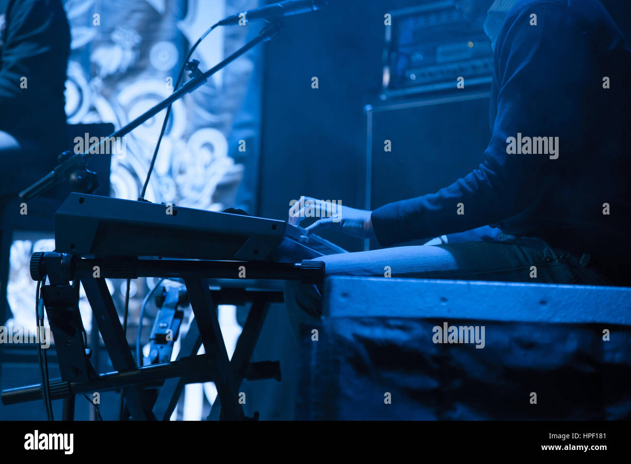 Artist plays on a synthesizer for the concert.. - Stock Image