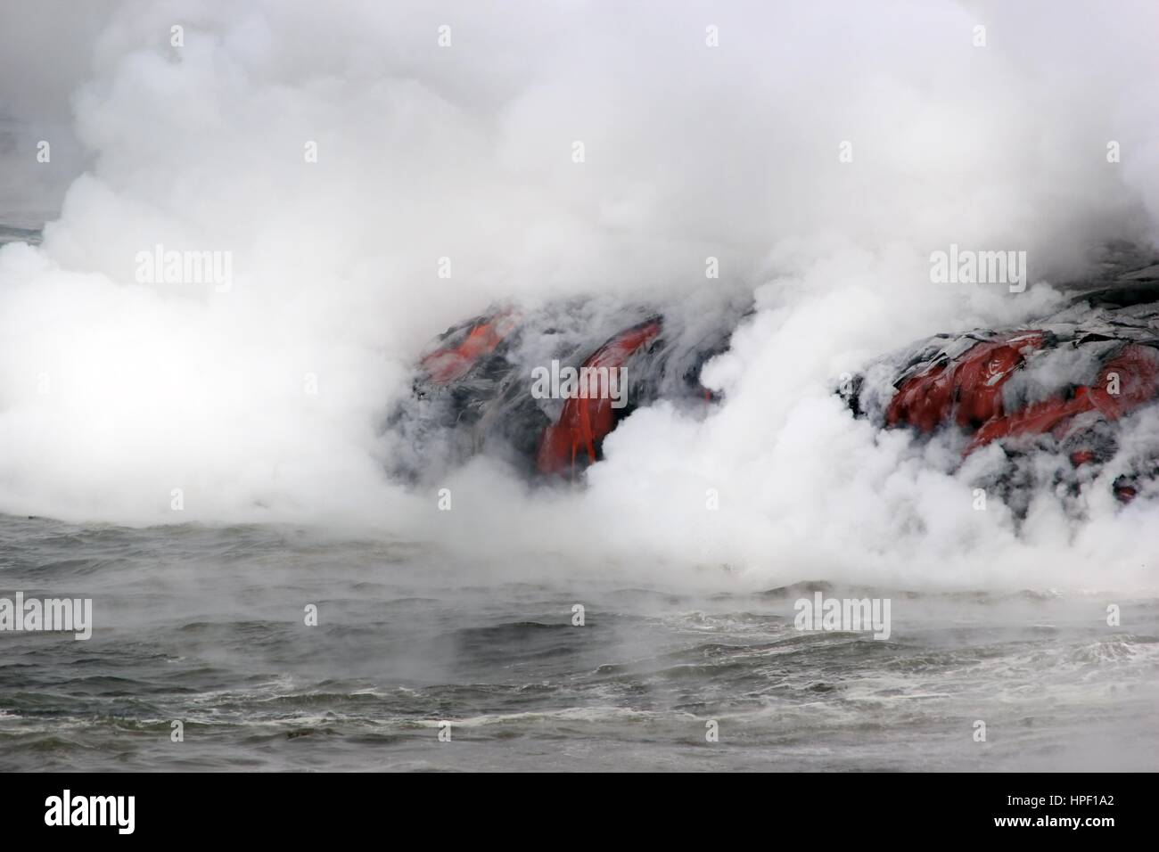 Lava Rohling in the ocean on Hawaii - Stock Image