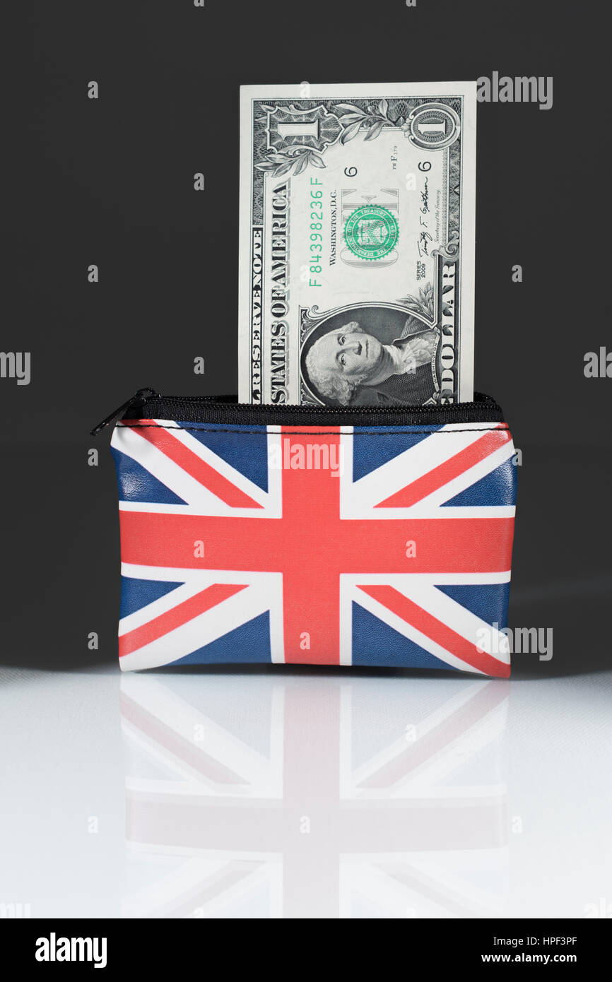 Union Jack coin purse with US Dollars ... set against a dark background. As metaphor for US Dollar-Sterling exchange - Stock Image