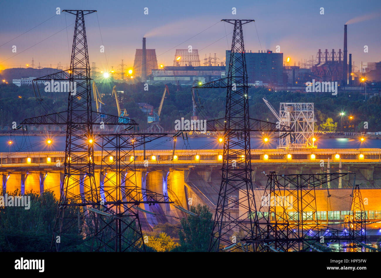 Industrial view with powerlines, Dneproges hydroelectric dam, cargo port and metallurgical plants in Zaporozhye, - Stock Image