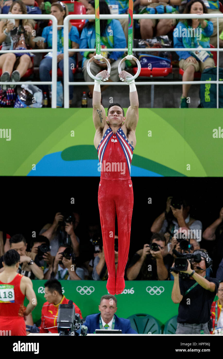 Rio de Janeiro, Brazil. 08 August 2016 Alexander Naddour (USA) performs on the Rings during Men's artistic team - Stock Image
