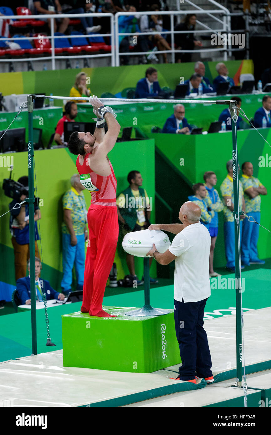 Rio de Janeiro, Brazil. 08 August 2016 Kristian Thomas (GBR) performs on the Horizontal Bar during Men's artistic - Stock Image