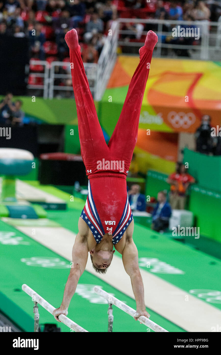 Rio de Janeiro, Brazil. 08 August 2016 Samuel Mikulak (USA) performs on the Parallel Bars during Men's artistic - Stock Image