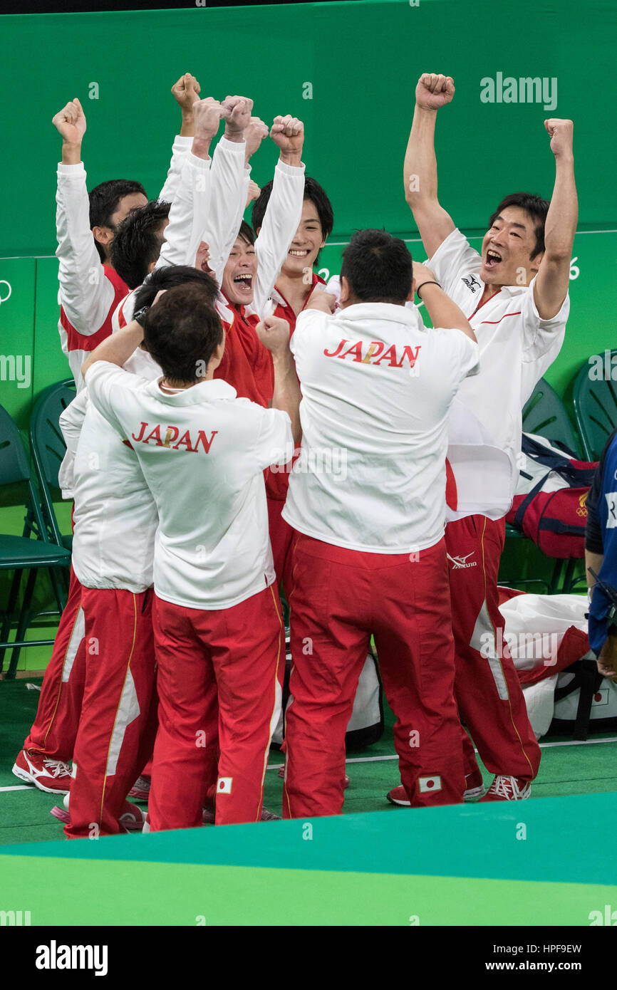 Rio de Janeiro, Brazil. 8 August 2016. Japanese Men's Gymnastics Team celebrates winning the gold medal at the - Stock Image