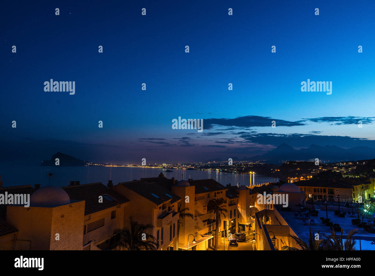 Dusk from the urbanization with Benidorm in the background - Stock Image