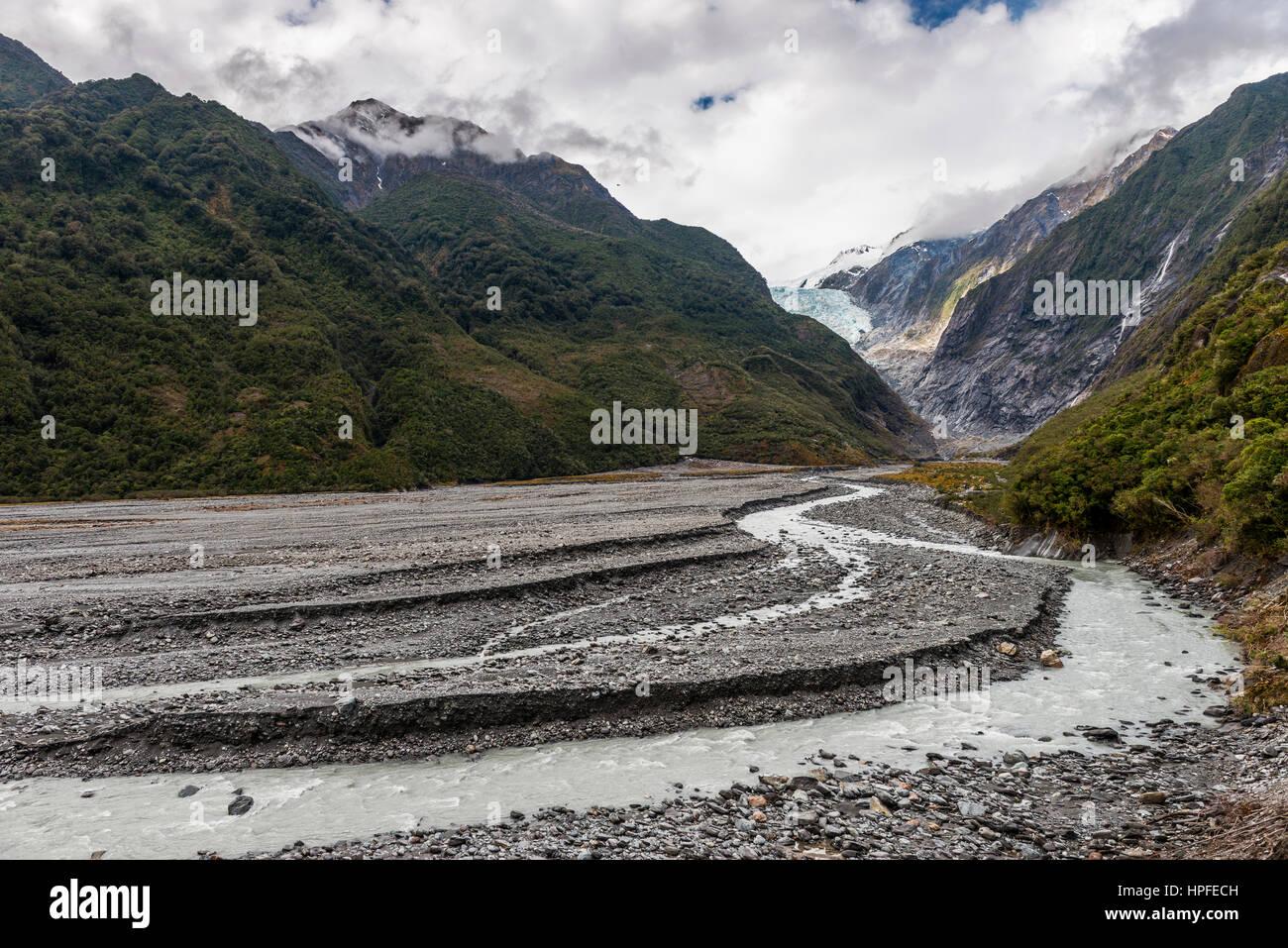 Glacial river and glacier tongue, Franz Josef Glacier, West Coast, Southland, New Zealand - Stock Image