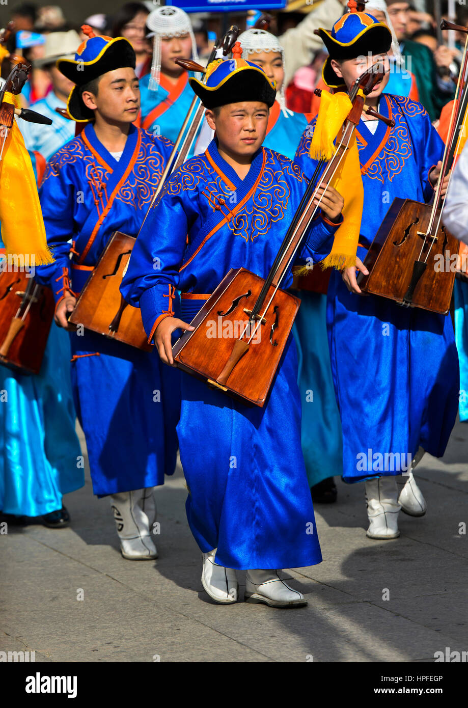 Youth in traditional Deel clothes and horse-head fiddle, Morin chuur, Festival of the Mongolian national costume, - Stock Image