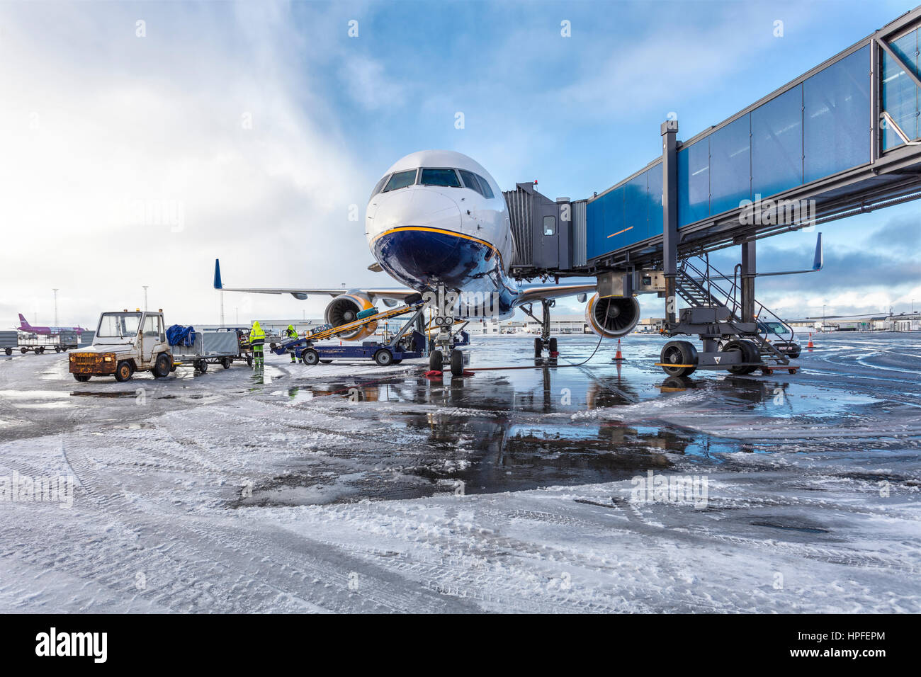 A jetliner being prepared for travel at Keflavik International Airport in Iceland. - Stock Image
