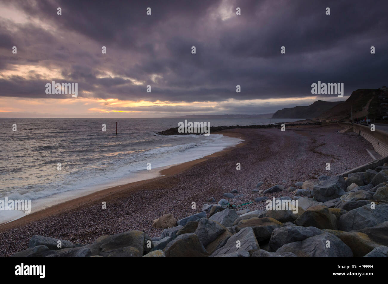 West Bay, Dorset, UK. 21st Feb, 2017. UK Weather. A stormy looking sky above West Bay in Dorset at sunset after - Stock Image