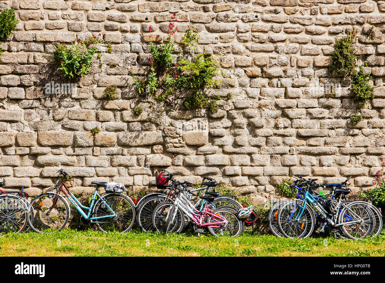 Bicycle and detail of Rampart, medieval city, Guerande, Loire-Atlantique, France Stock Photo