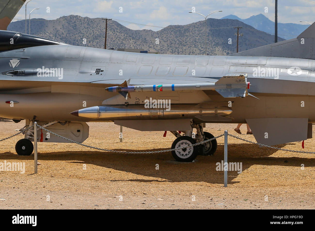 F-16 fighter loaded with Inert AIM-9 missile and B-61 nuclear bomb at National Museum of Nuclear Science & History - Stock Image