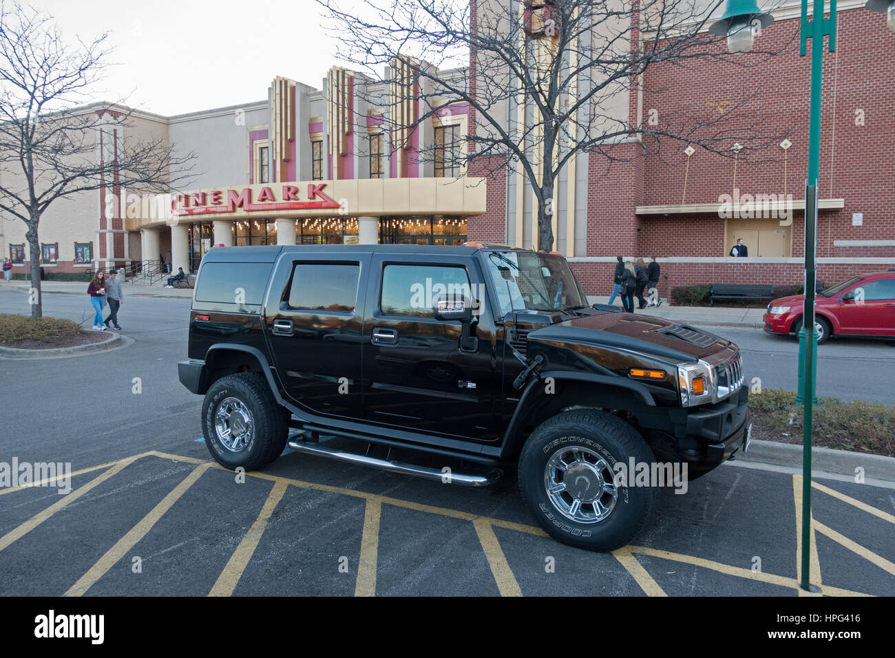 Black Hummer H2 SUV parked in the CineMark theater parking lot. Downers Grove Illinois IL USA - Stock Image