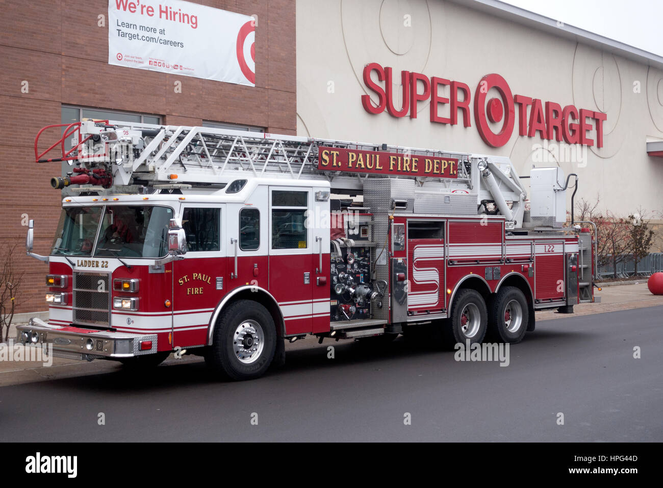 Fire Department Dept truck engine parked outside Super Target picking up supplies and food. St Paul Minnesota MN - Stock Image