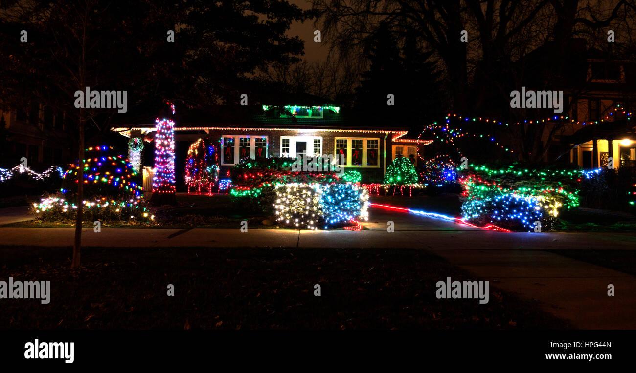 Colorful Christmas Lights On House.House And Yard Decorated With Colorful Christmas Lights