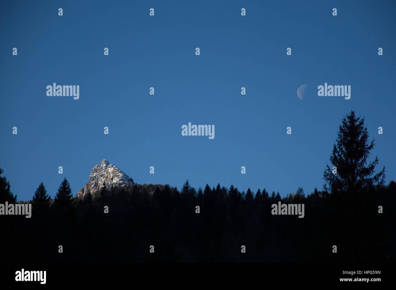 Moon and mountain Dolomites Veneto Italy - Stock Image