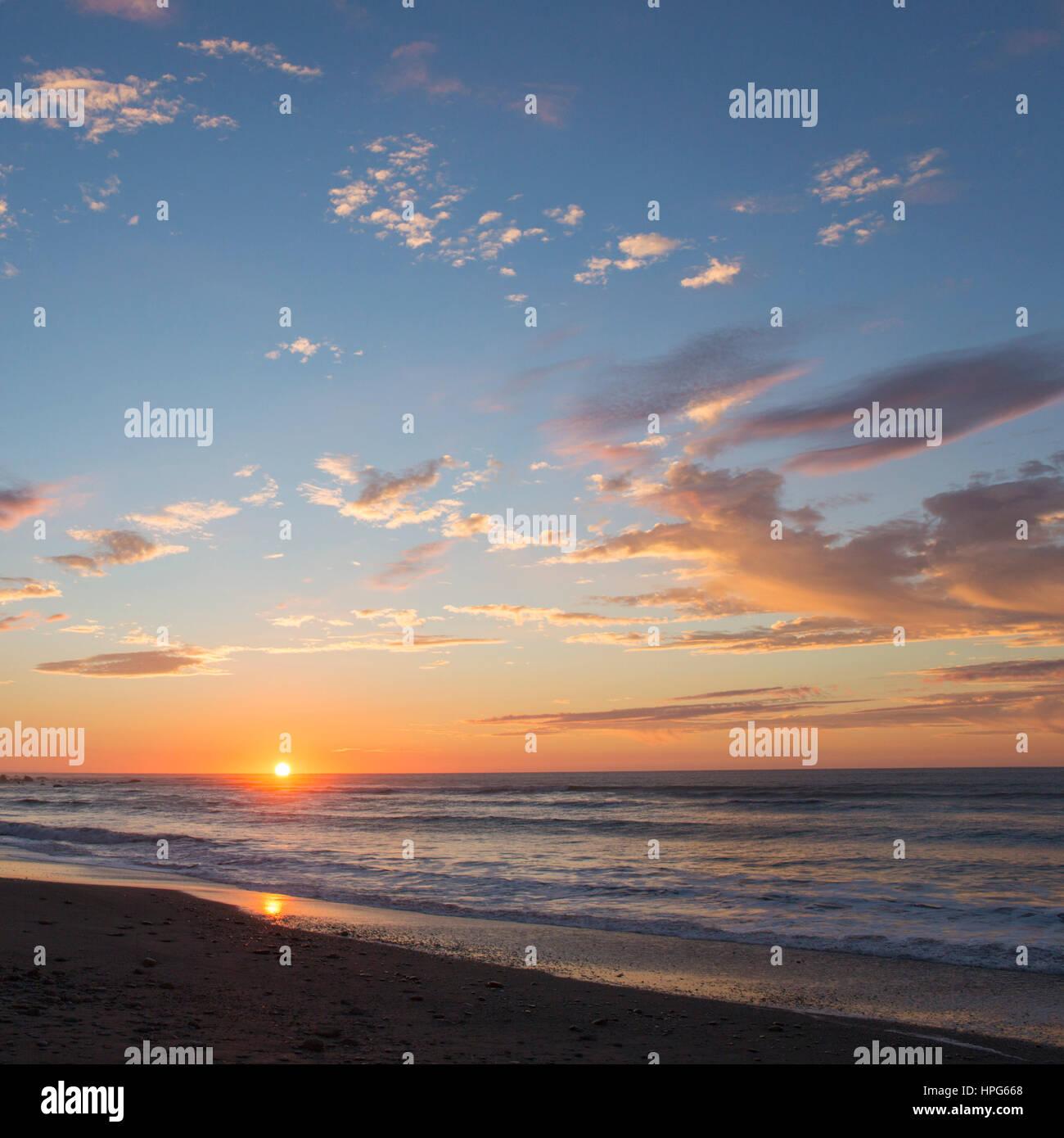 Okarito, Westland Tai Poutini National Park, West Coast, New Zealand. Colourful sunset over the Tasman Sea. Stock Photo