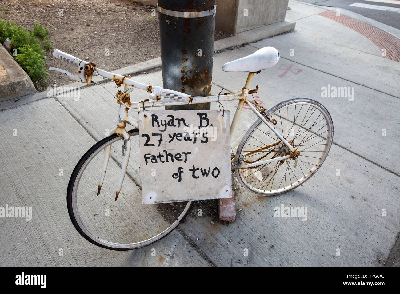 Ghost bike in Chicago's Chinatown district memorializing a man killed in a bicycle accident. - Stock Image