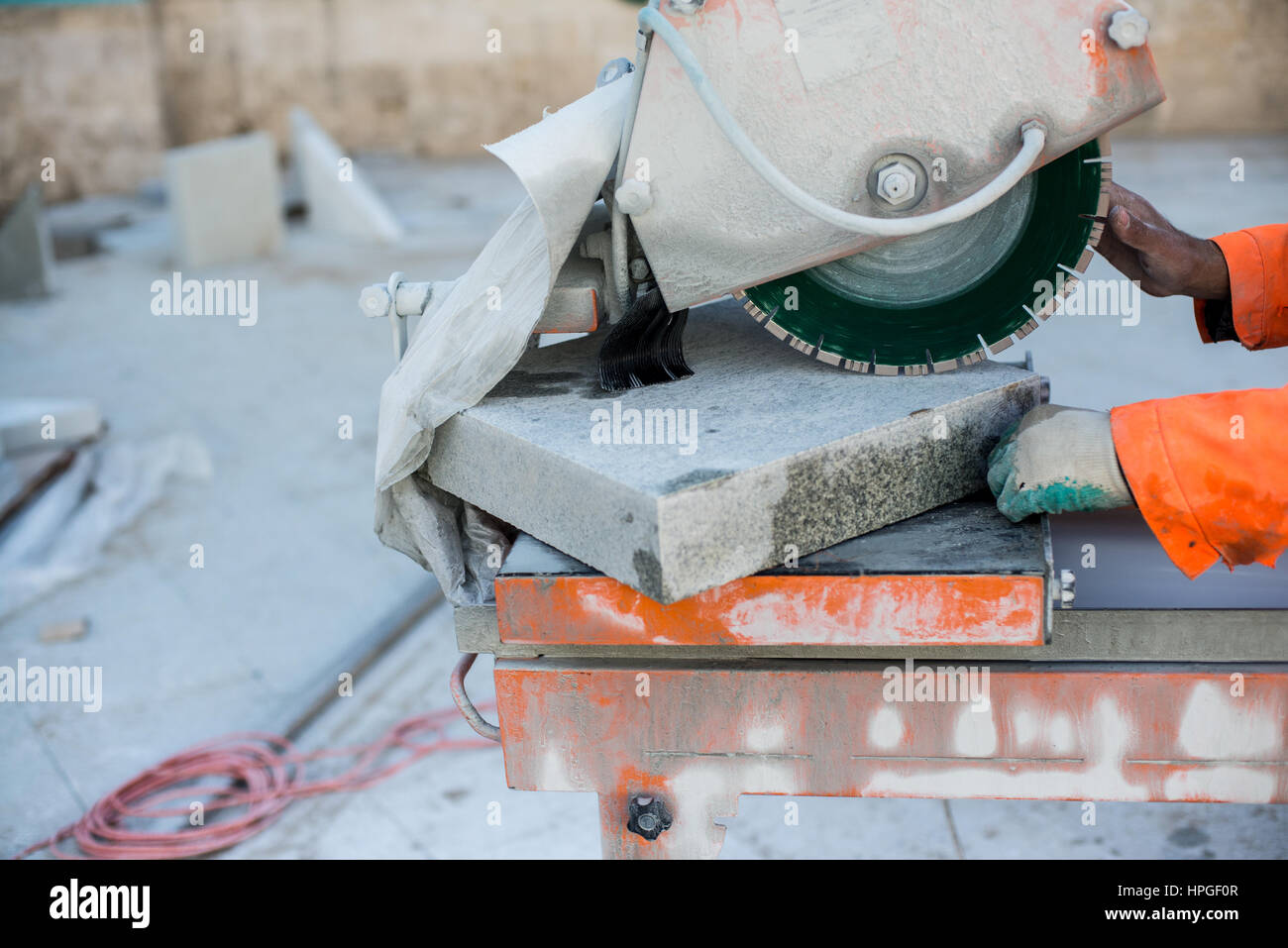 Machine has sharp blade which makes clean cut in stone or granite. It uses abrasive action to slice through material - Stock Image