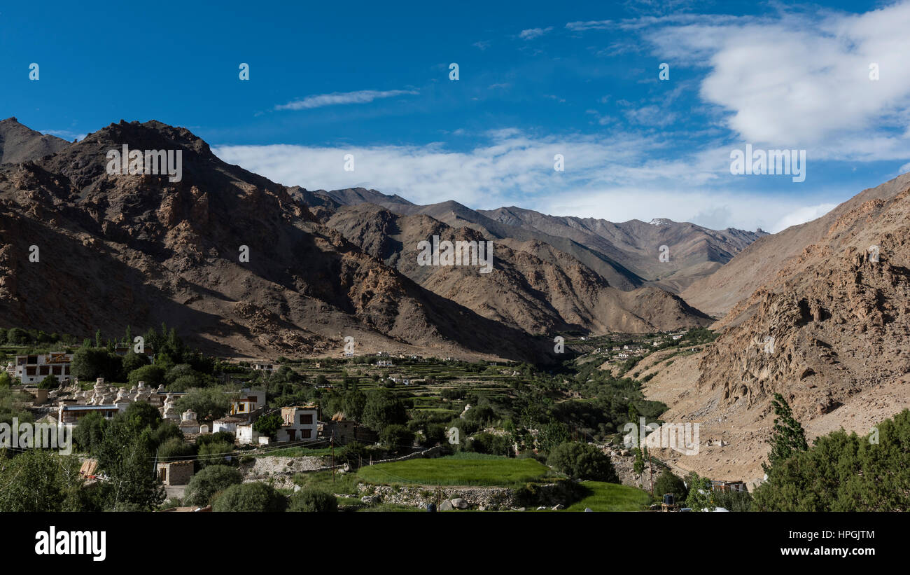 Human settlement in mountain valley - Stock Image