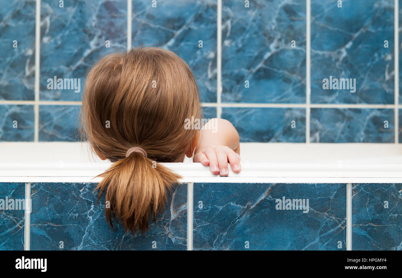 Little girl taking a bubble bath. Healthcare and hygiene concept ...
