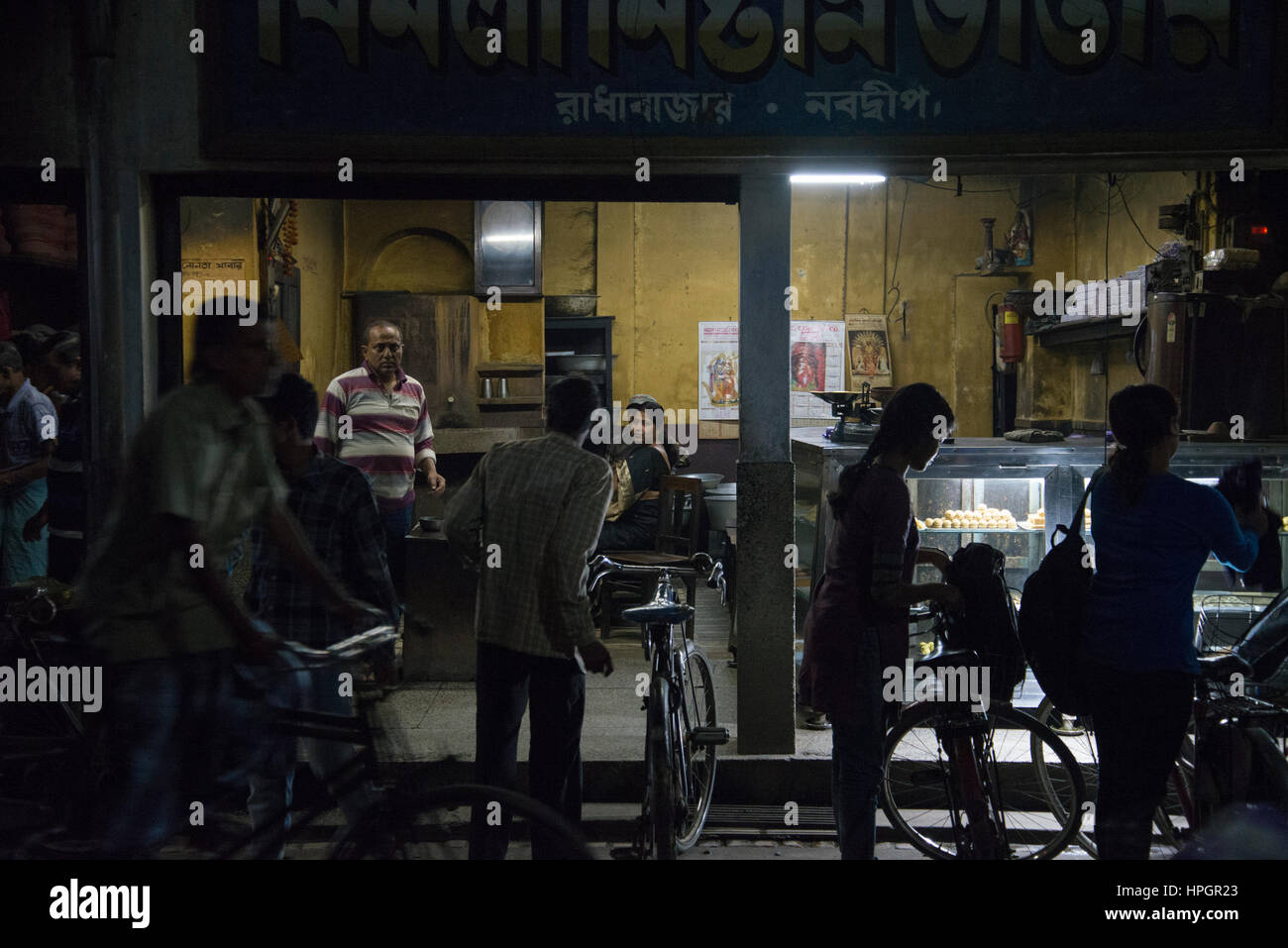Sweet shop at night, Navadwipa, India. - Stock Image