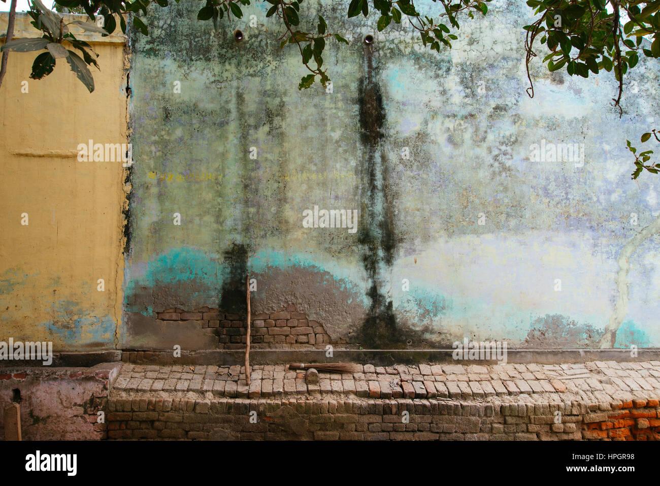 Village wall blue paint fade, India. Stock Photo