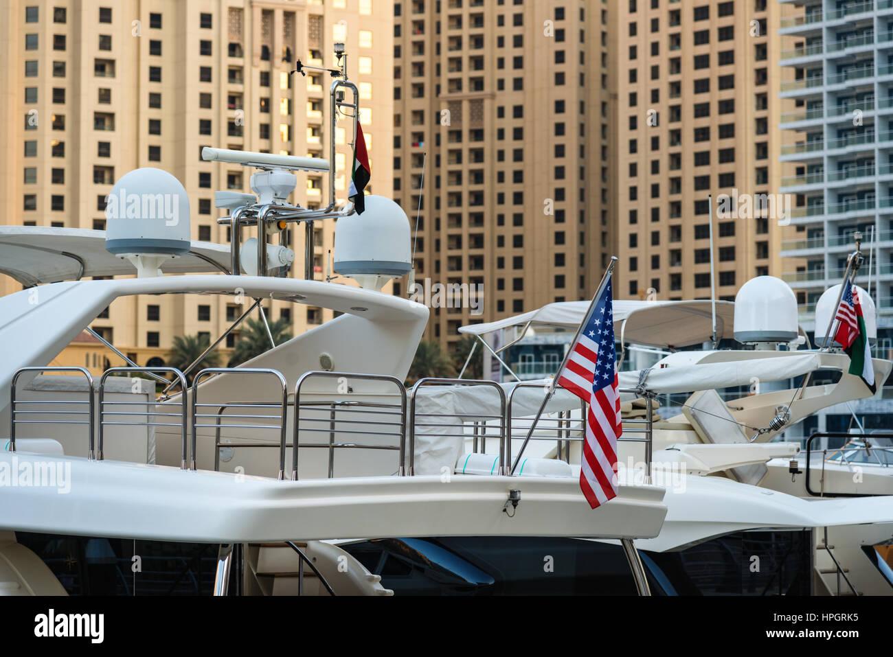 Modern yachts in harbor in megapolis - Stock Image