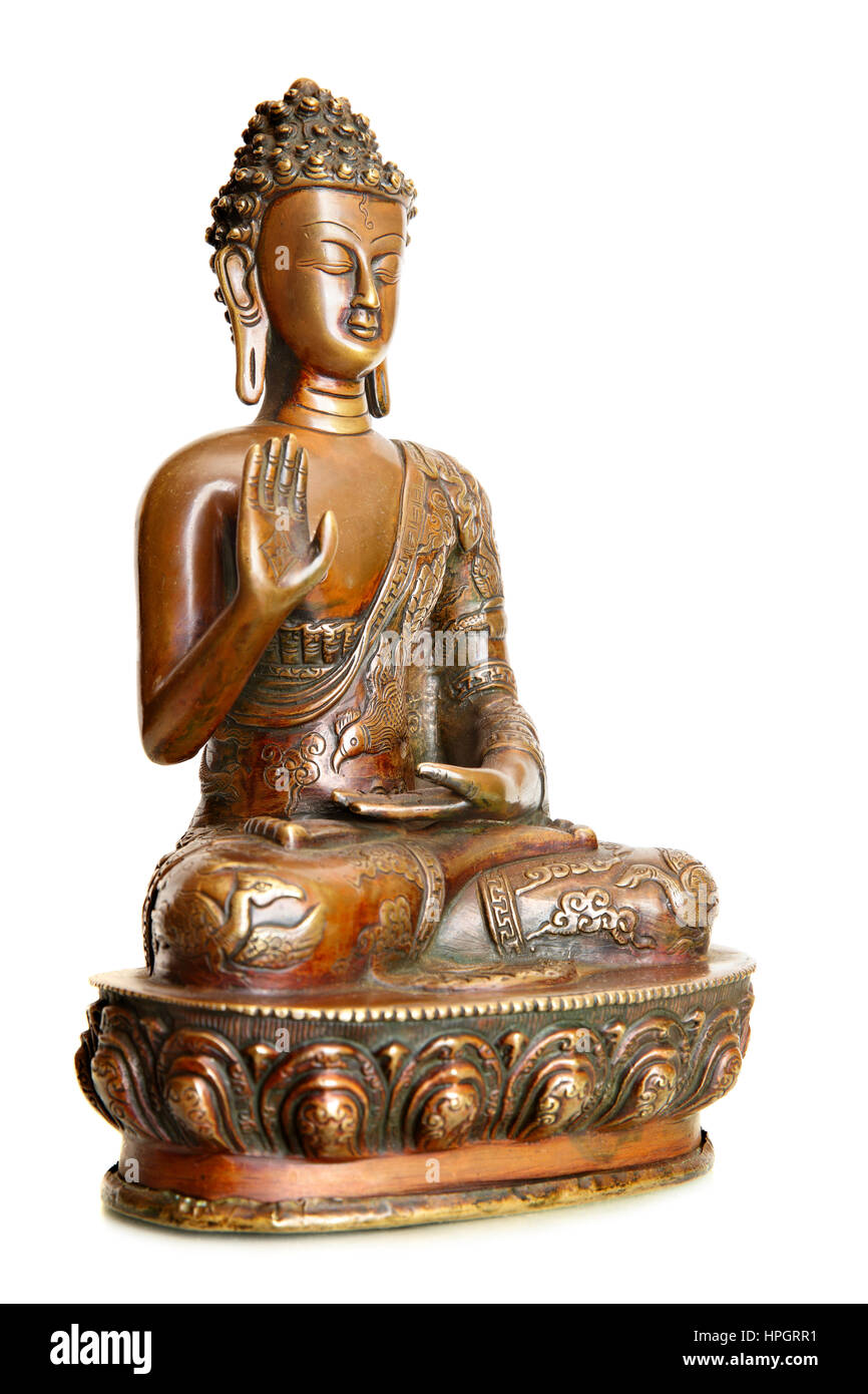 Figurine of blessing Buddha isolated over the white background - Stock Image