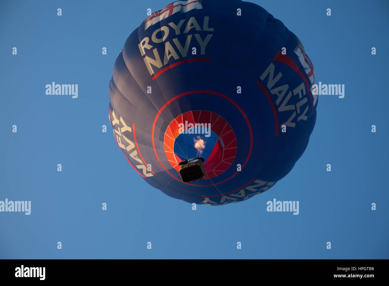 A hot air balloon from below showing the Royal Navy logo - Stock Image