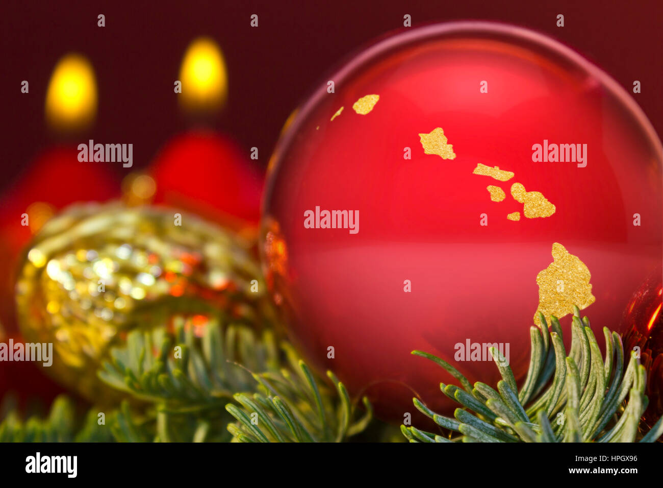 a glossy red bauble with the golden shape of hawaiiseries stock - Merry Christmas In Hawaii