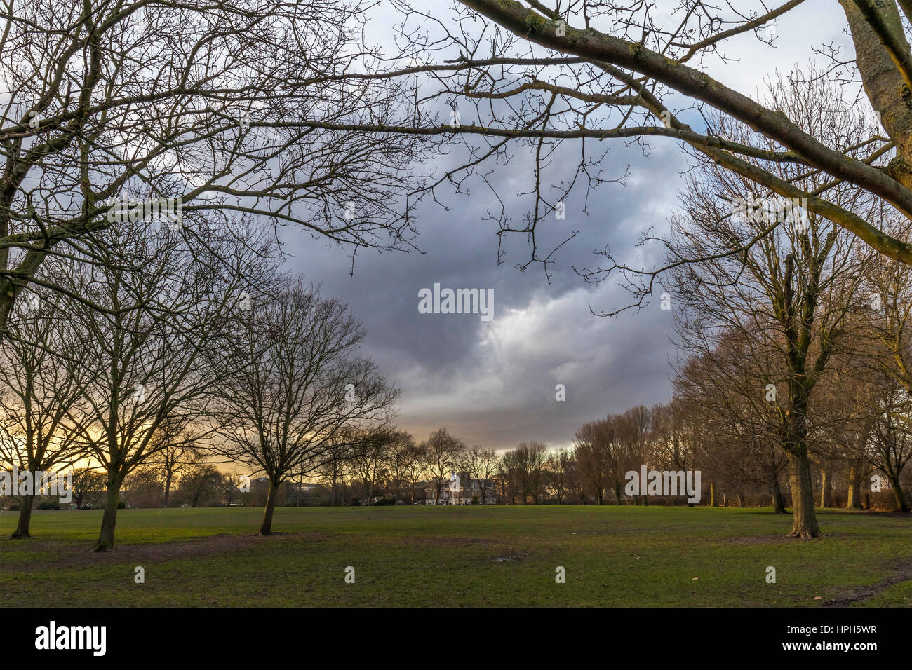 Sunset at a regents park in unted kingdom on a overcast sky - Stock Image