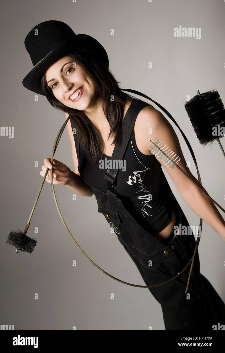 Rauchfangkehrerin, Gluecksbringer - female chimney sweep, Model released - Stock Image