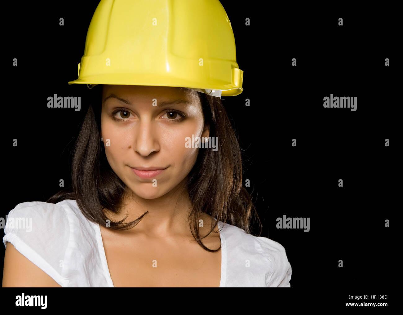 Junge Frau mit Bauarbeiterhelm - young woman with work helmet, Model released Stock Photo