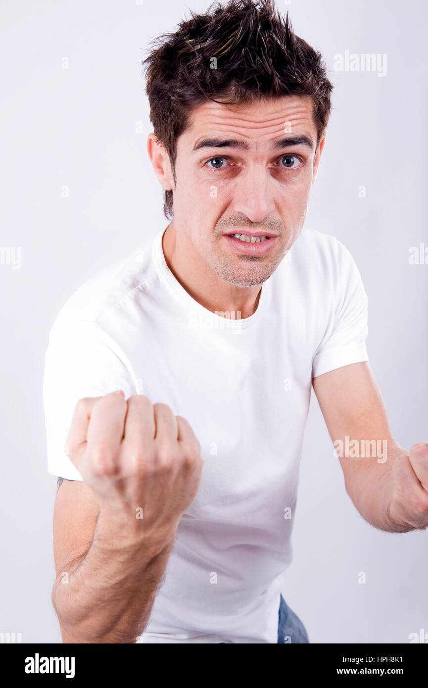 Aggressiver Mann mit geballter Faust - aggressive man with clenched fist, Model released Stock Photo