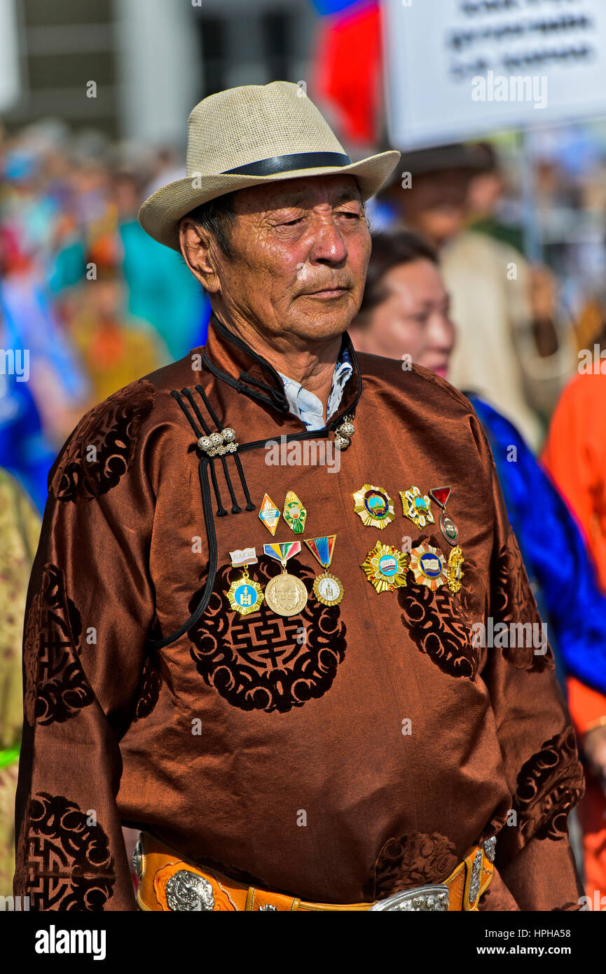 Man in a traditional deel costume with medals at the Mongolian National Costume Festival, Ulaanbaatar, Mongolia - Stock Image