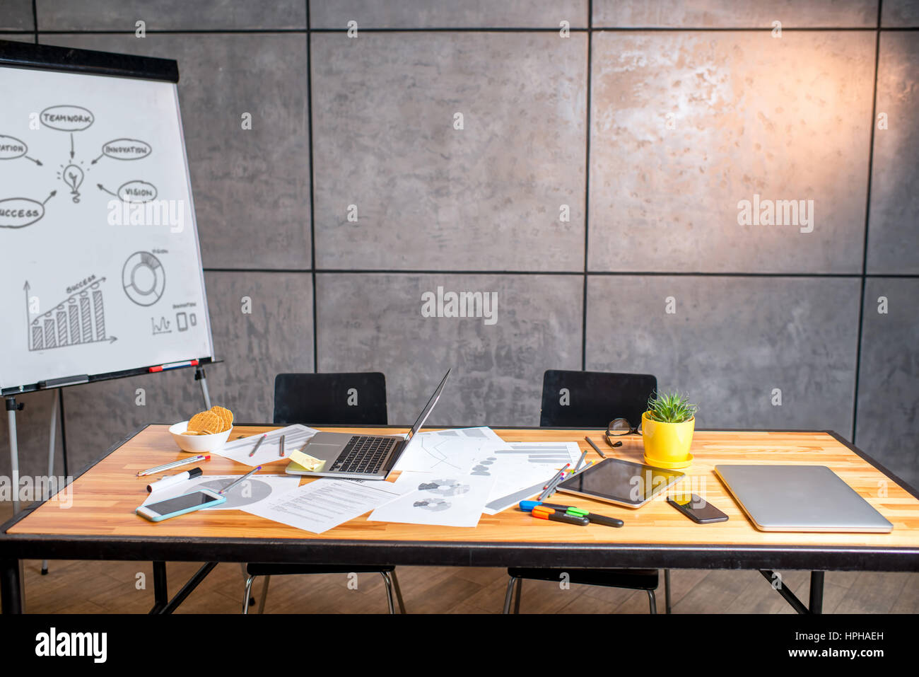 Working place with gadgets and whiteboard - Stock Image