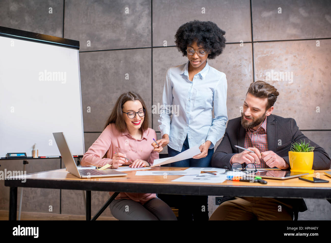 Coworkers working together indoors - Stock Image